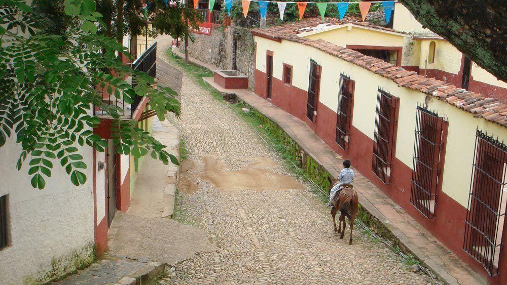 local boy riding a horse in Mazatlan