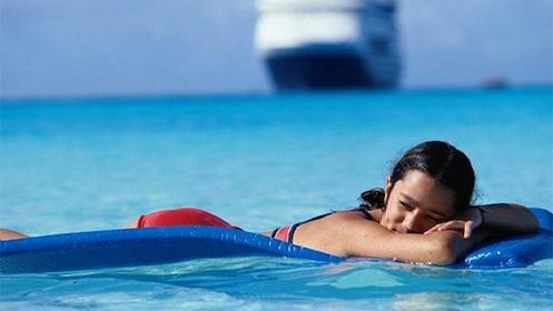 Woman floating in=Mazatlan