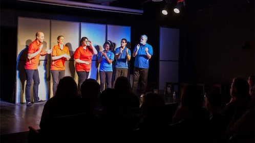 Comedy troupe onstage with audience at National Comedy Theater in Phoenix