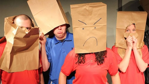 Group with paper bags on their heads during a performance in Phoenix