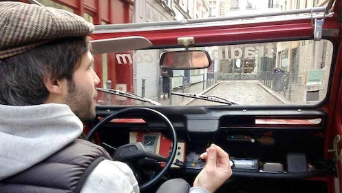 Man driving on the Lille with Tastings tour in a 2CV tour in Marseille, France