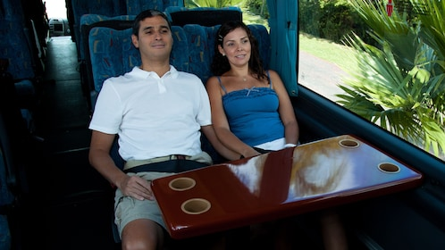 Two people on a luxury bus
