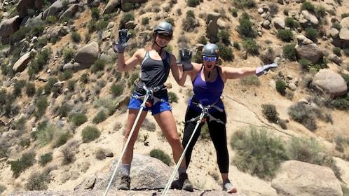 Pair of women rappelling in Arizona