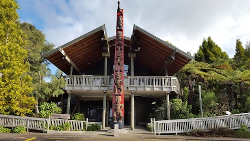 front of house with totem pole