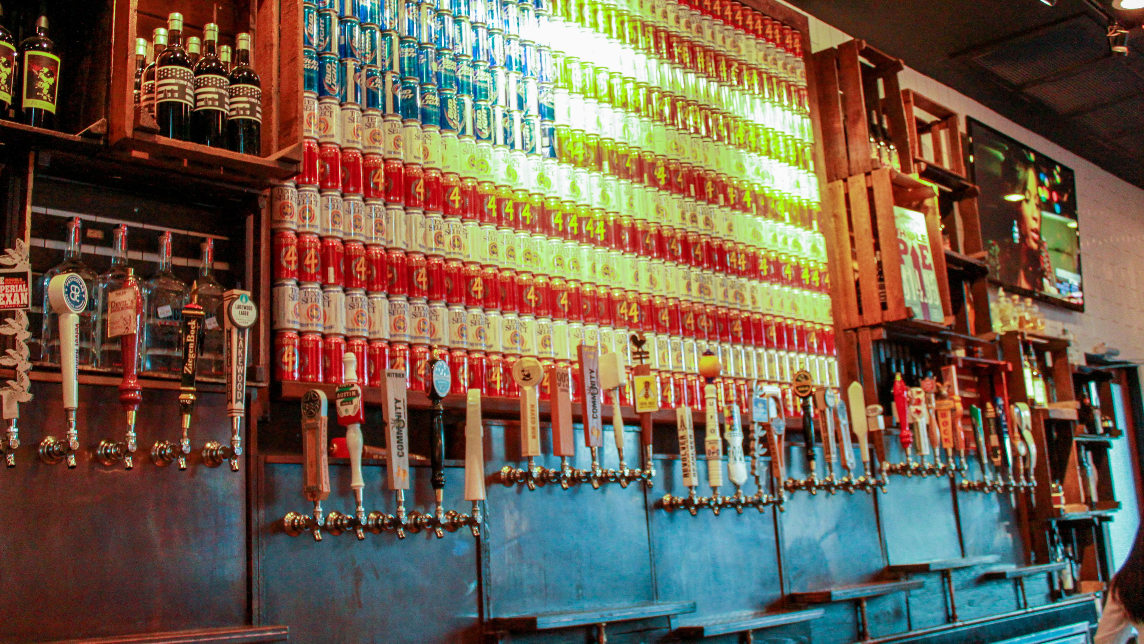 Bar with an American flag made of beer cans in Dallas