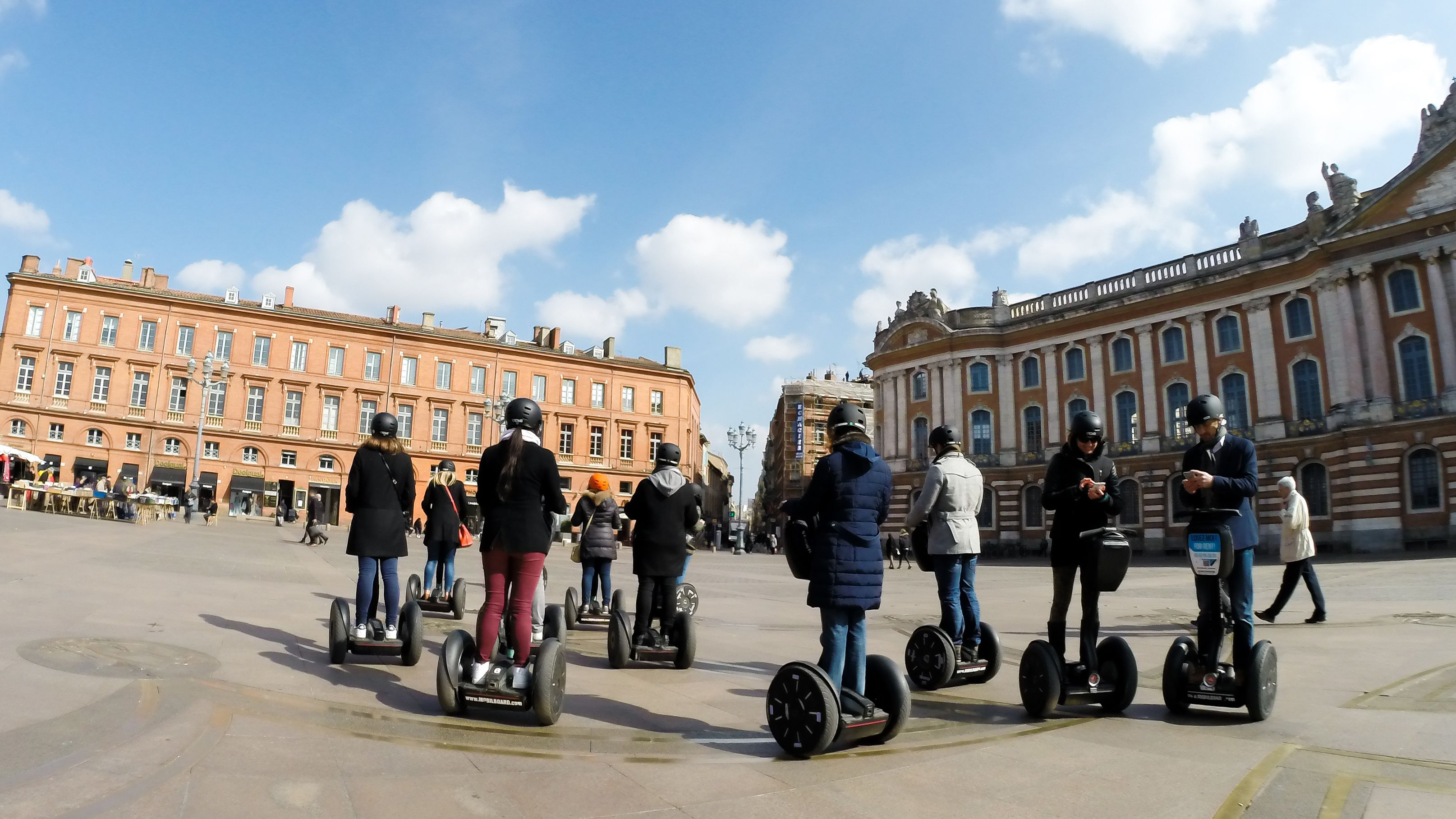 Segway tour group in town square of Toulouse