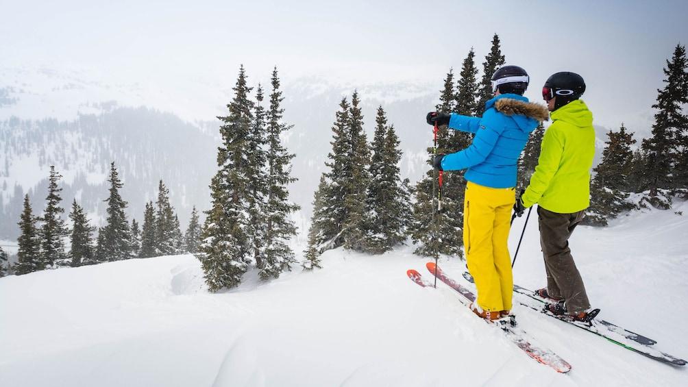 Cargar ítem 2 de 5. Couple getting ready to ski in Colorado