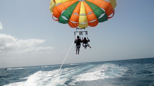 Two people Parasailing in the Bahamas