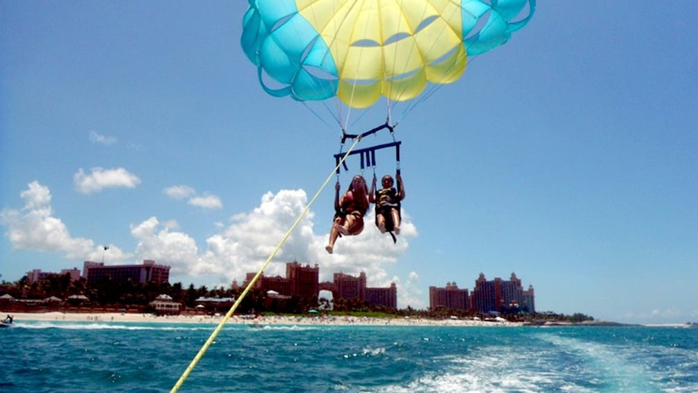 Show item 5 of 5. Two people Parasailing in the Bahamas