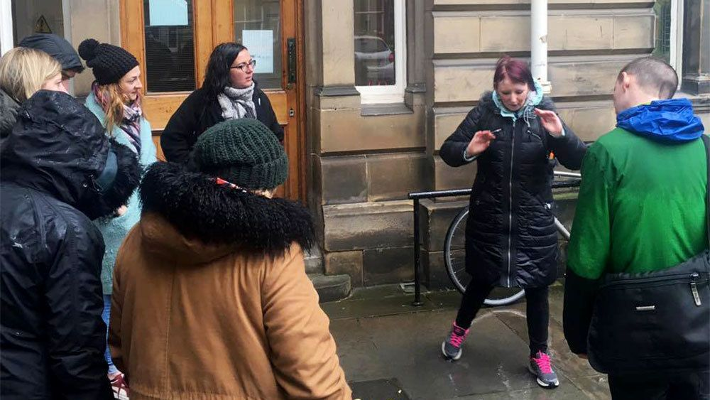 Tour guide with group in Edinburgh