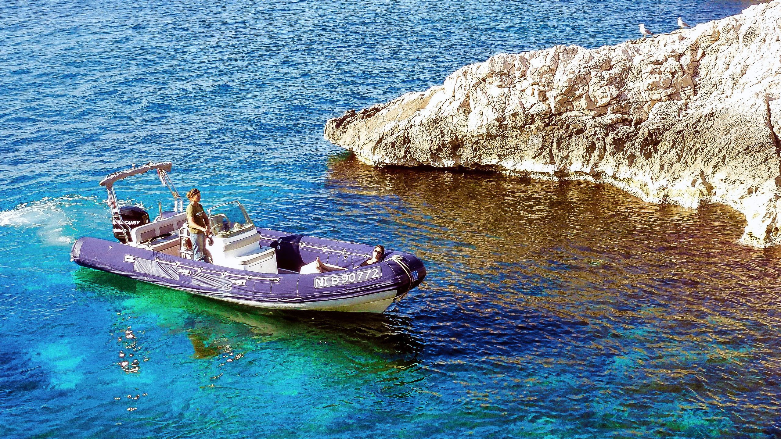 Boat in the clear blue water of the Marseille Calanques