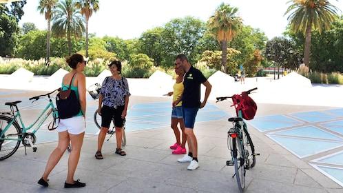 Bike group talking in shade in Valencia