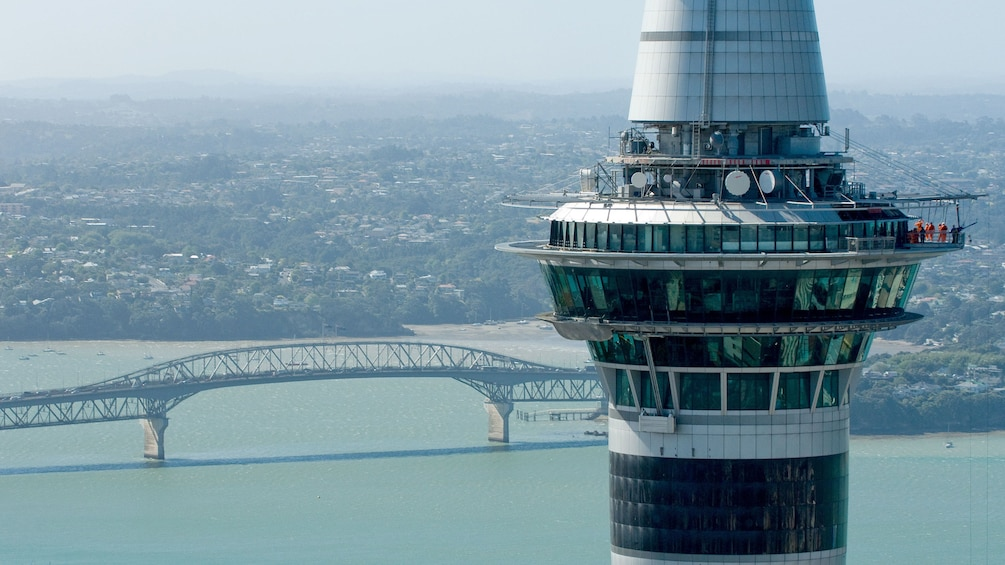 Show item 1 of 5. Sky Tower with city in the distance in Auckland