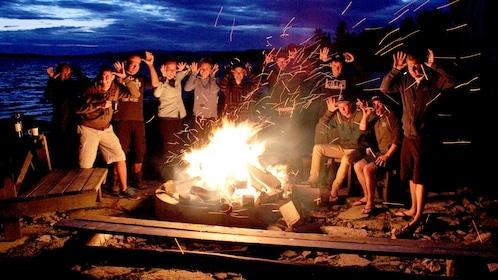 Tour group next to a Bonfire