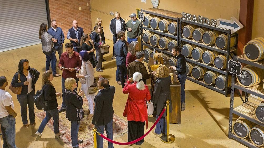 people tasting at distillery