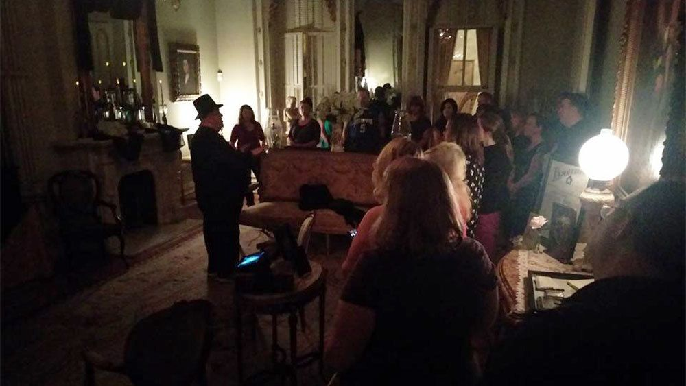 Tour group in living room inside Woodruff Fontaine House in New Orleans