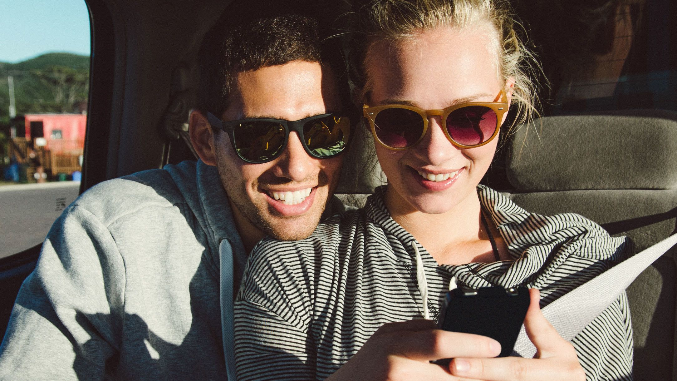 Couple using a smart phone in Boise