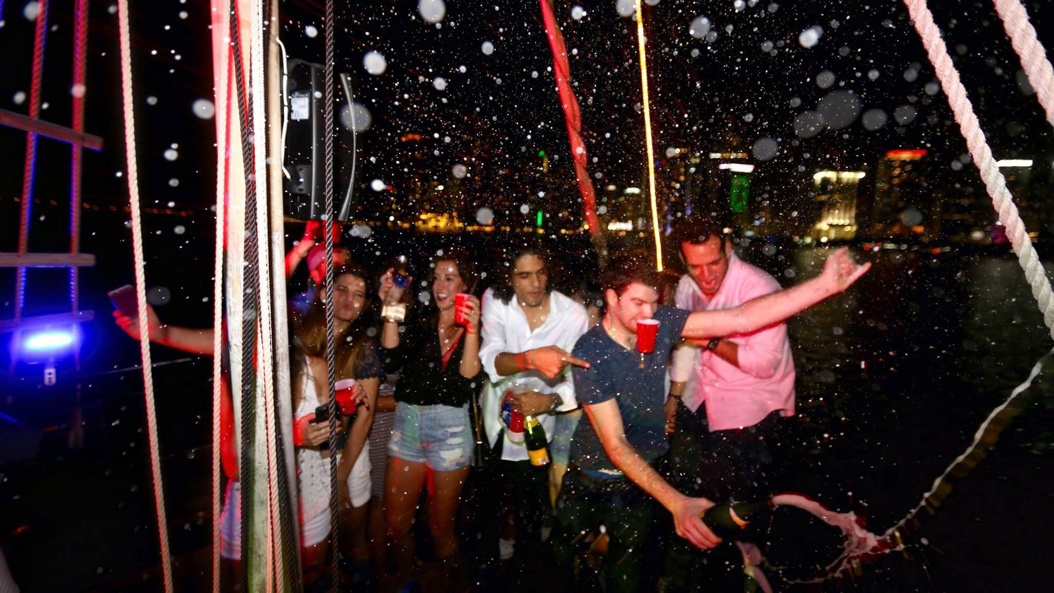 Group partying on a boat at night in Miami