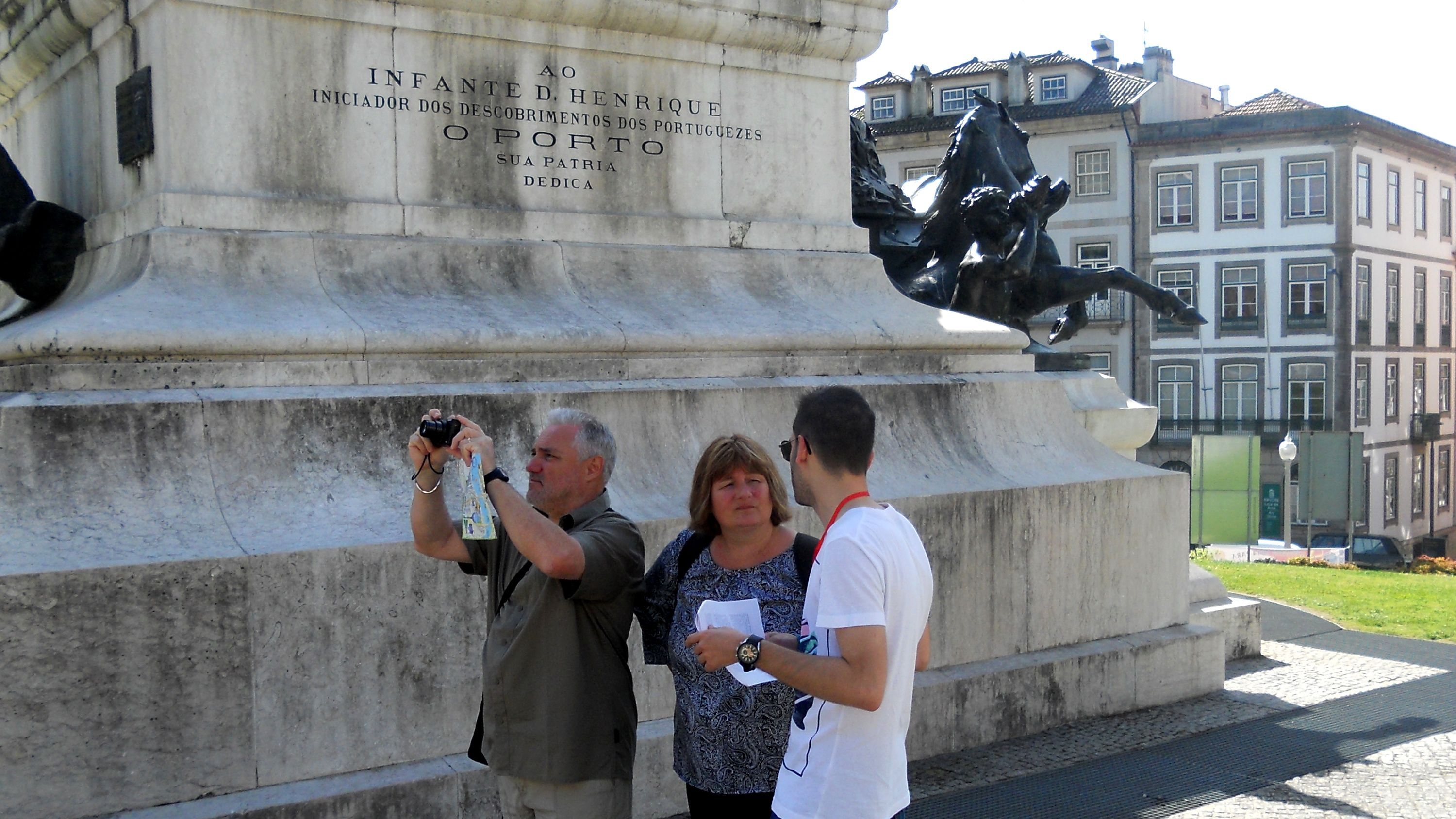 Tour group next to a statue in Portugal