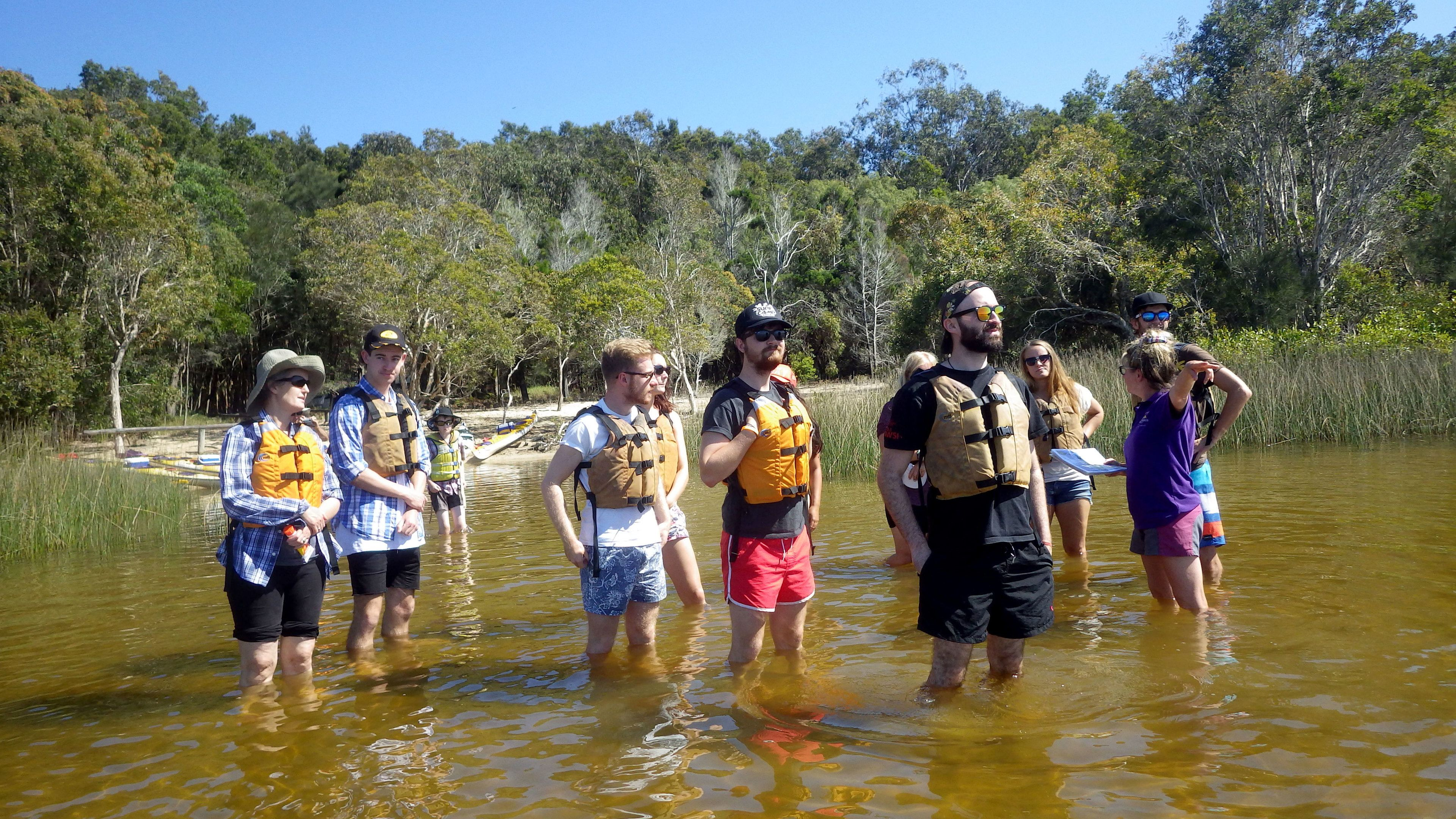 Kayaking group wading in the water in Australia