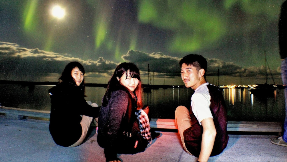 Show item 2 of 6. Group enjoying the views of the aurora