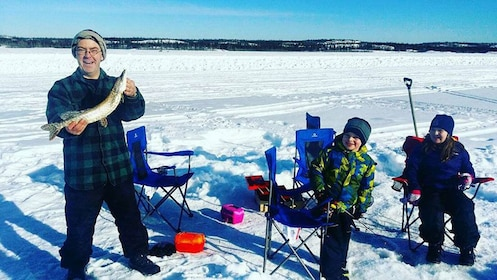 Group Ice Fishing on a lake