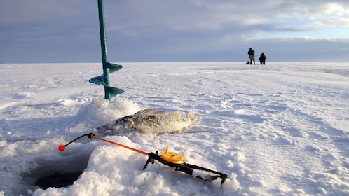 Ice fishing hole and drill