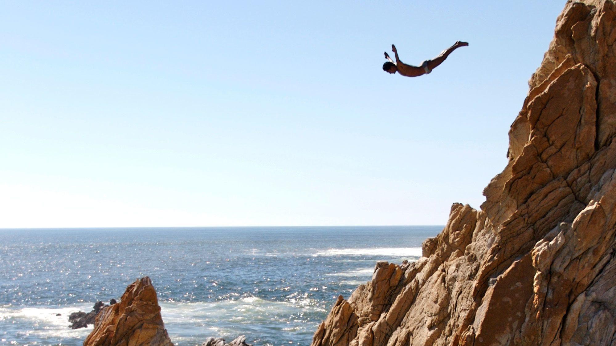 Cliff diver midair in Acapulco