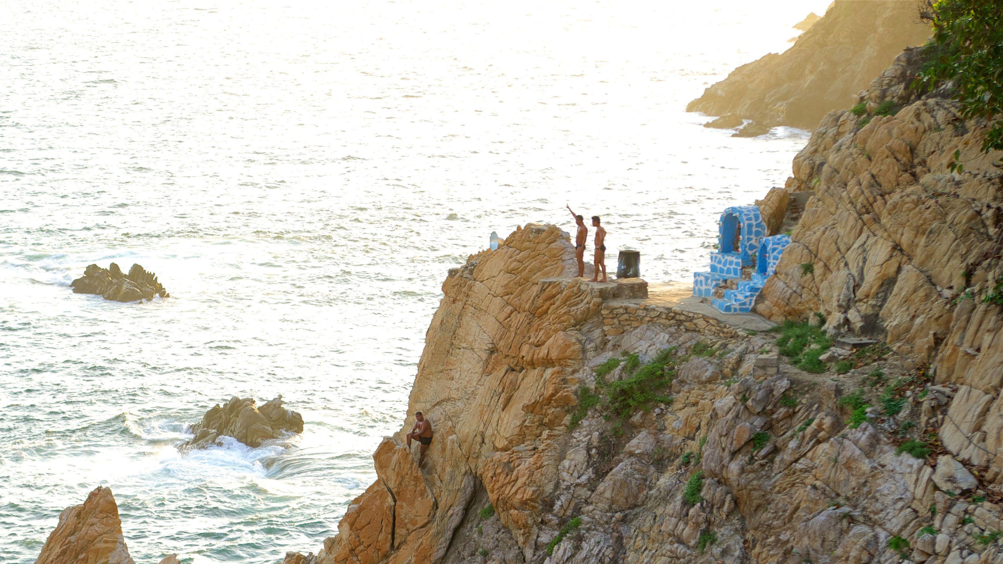 Cliff divers preparing to jump in Acapulco