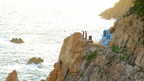 Cliff divers preparing to jump in Acapulco