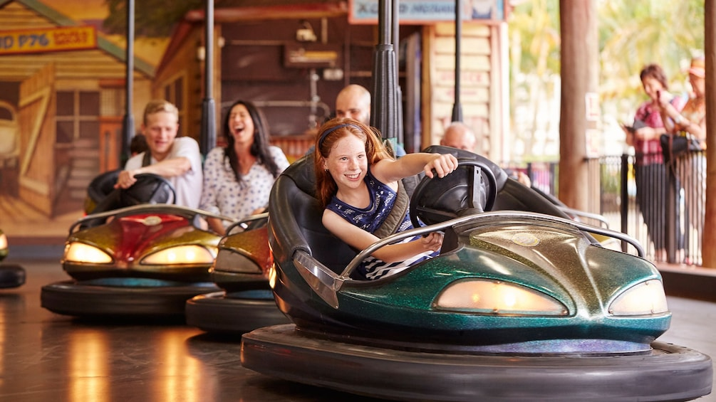 Show item 5 of 10. People riding bumper cars at Aussie World