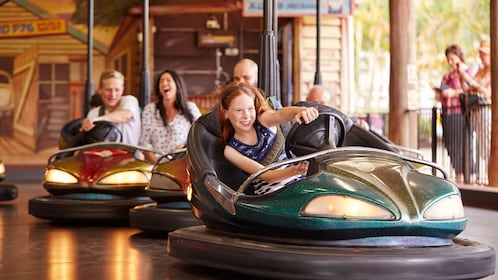 People riding bumper cars at Aussie World