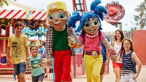 Kids walking with characters from Aussie World in Sunshine World