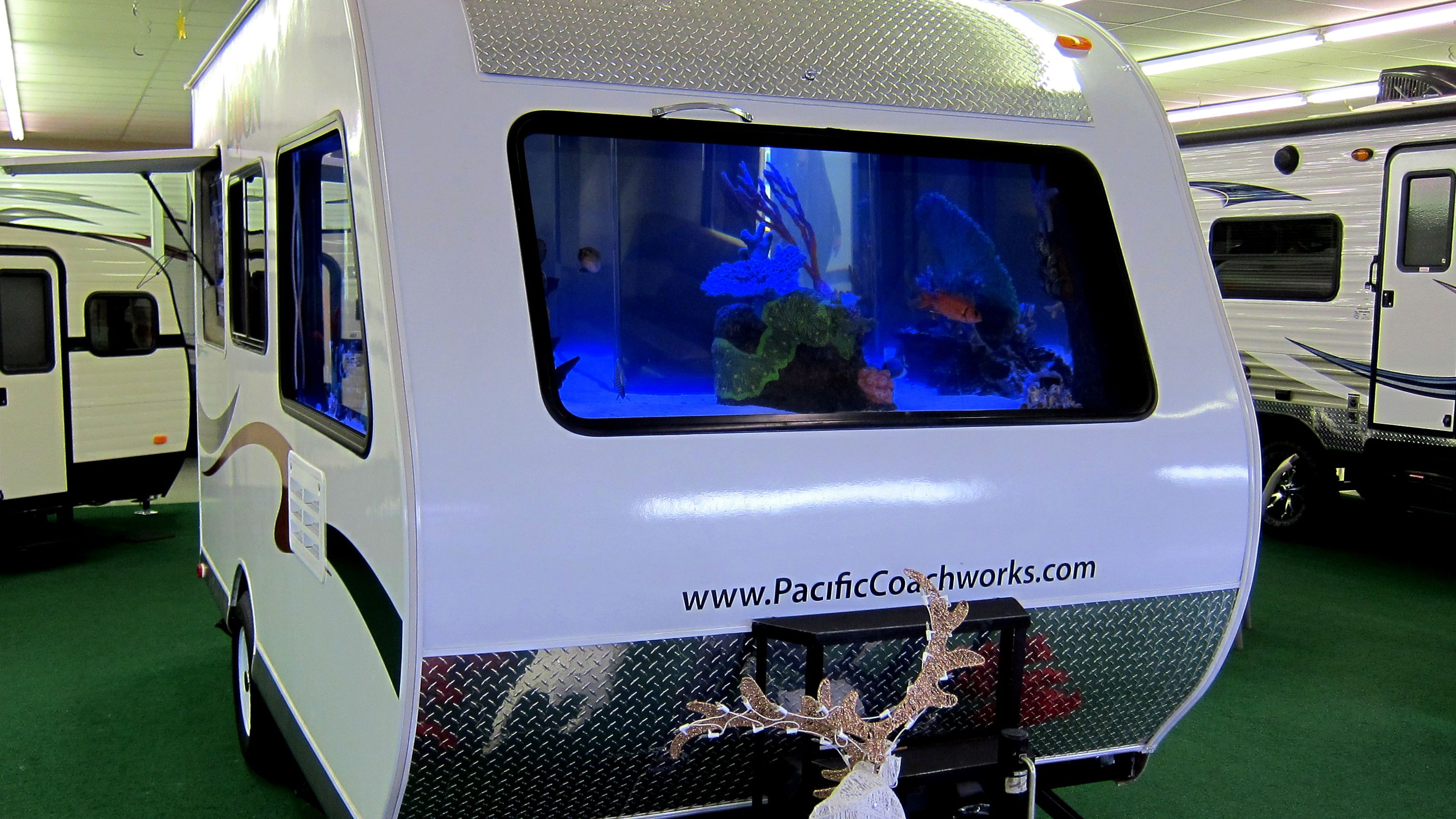 A trailer with fish tank windows