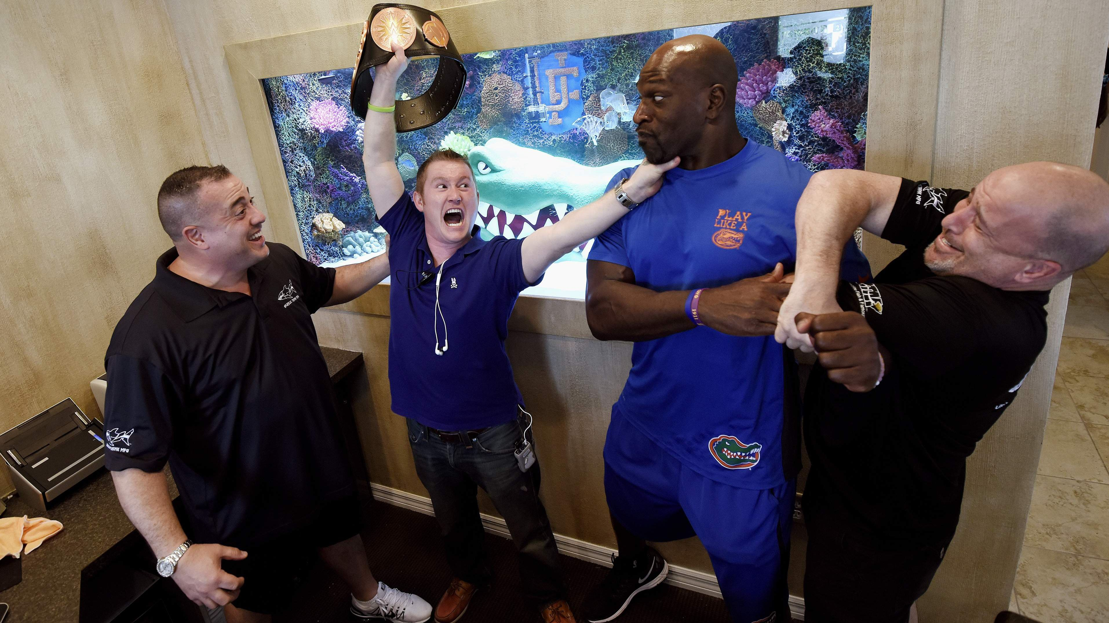 Cast of Tanked pose with NFL player