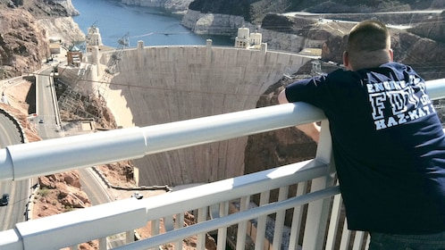 Person looks down on the Hoover Dam