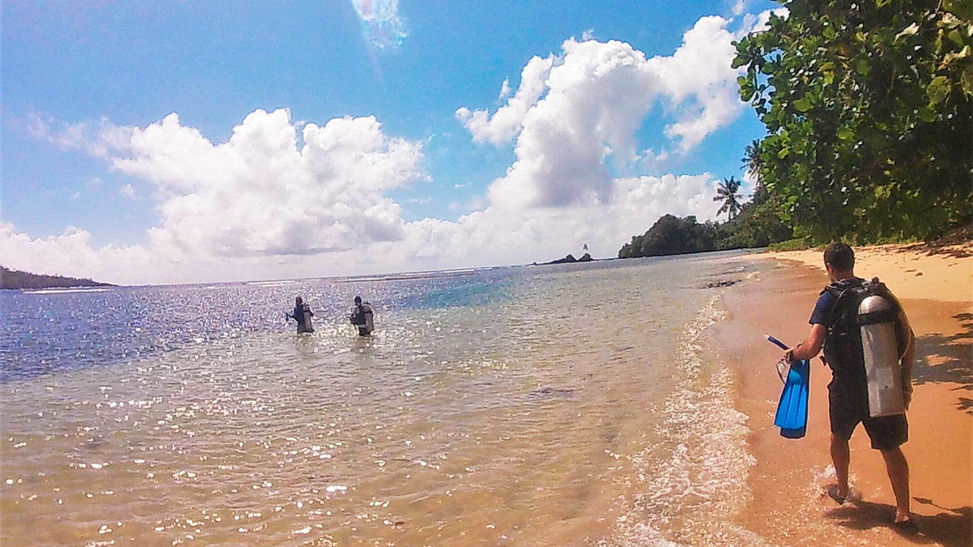 Snorkelers at Forgotten Bay in Samoa