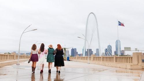 Group of women walking across a bridge in Dallas