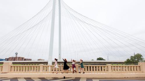 Group of women crossing a bridge in Dallas
