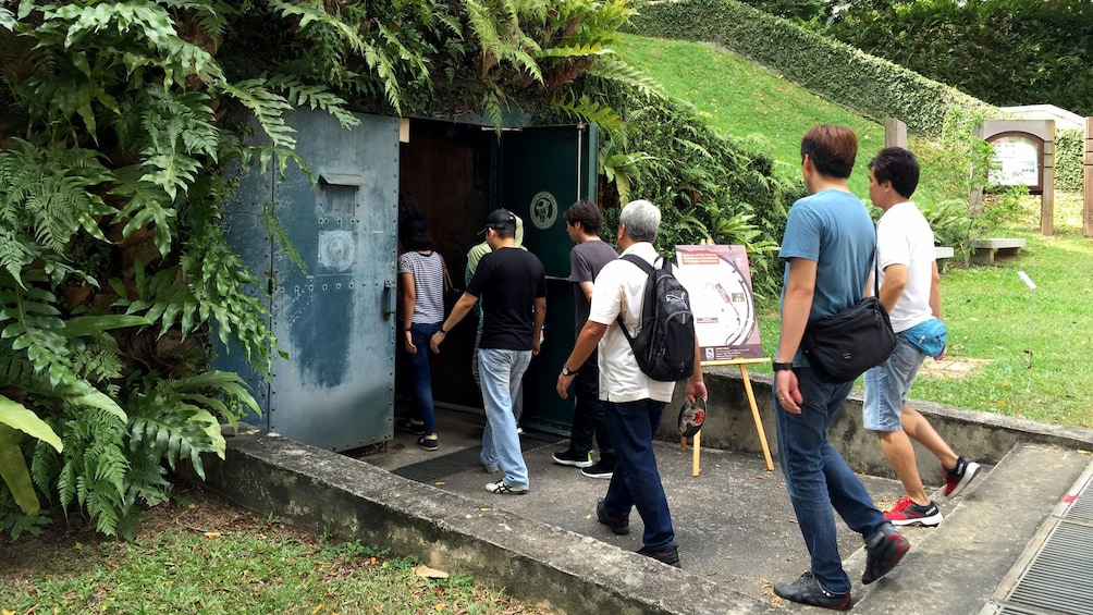 Show item 1 of 4. Tour group entering the Battlebox bunker at Fort Canning in Singapore