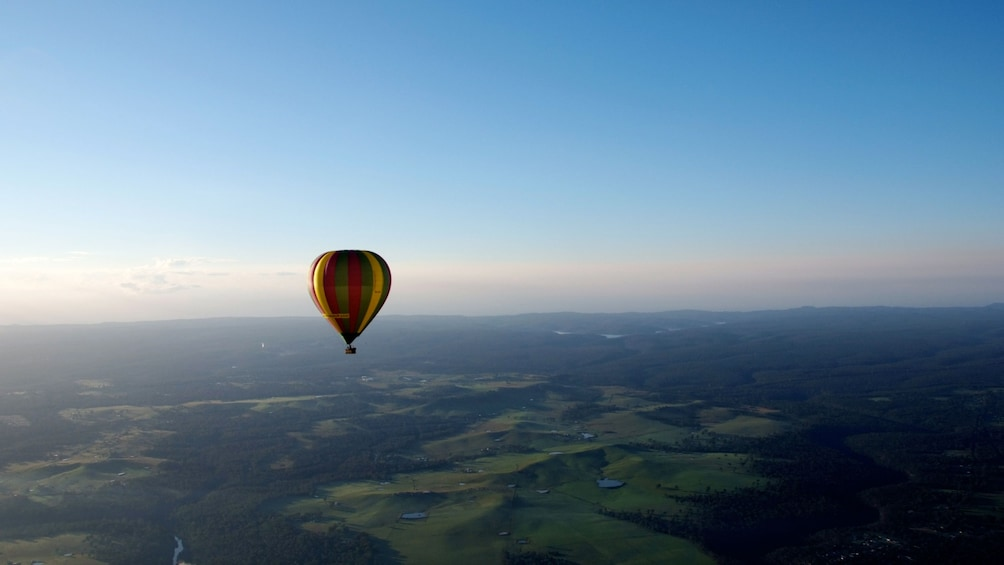 Show item 3 of 4. hot air ballon over landscape in Sydney