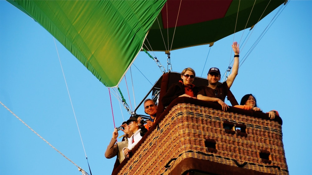 Show item 4 of 4. People enjoying hot air ballon ride in Sydney