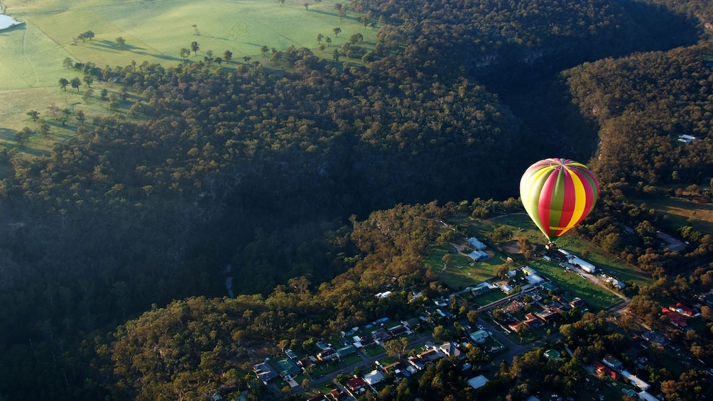 Show item 2 of 4. hot air ballon floats high above landscape in Sydney