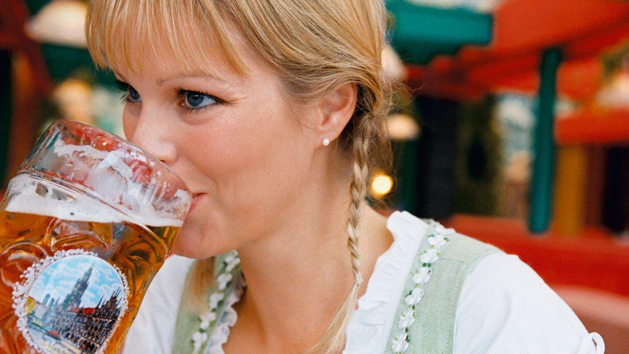 Woman drinking beer at Oktoberfest