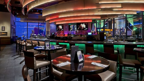 Enjoy food and beverage at the bar of the Hard Rock Cafe on the Vegas strip