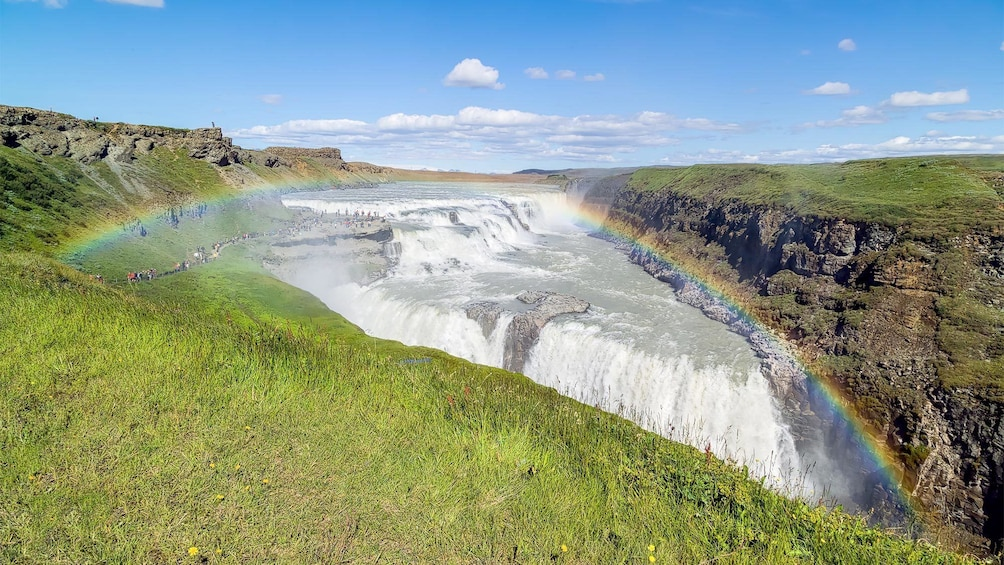 Rainbow over the waterfalls in Reykjavik