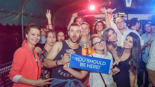 Large group dancing and drinking on the Pub Crawl & Party Cruise tour in Budapest