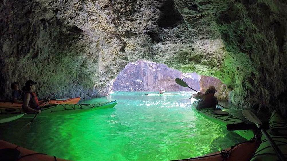 Kayakers in a cave along the Colorado River