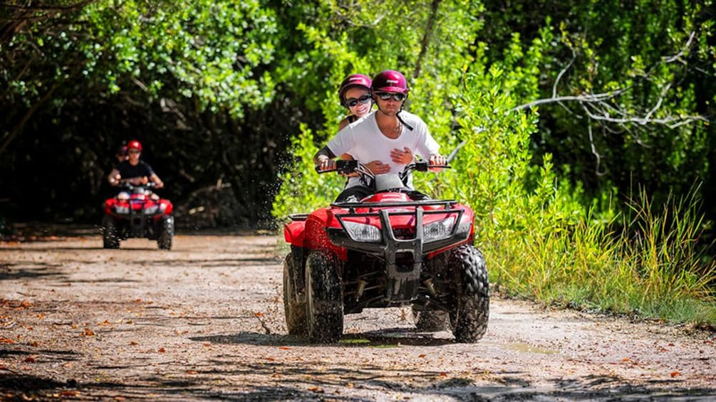 Show item 2 of 10. Two ATVS on a trail in Cancun