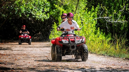 Two ATVS on a trail in Cancun